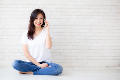 Beautiful of portrait young asian woman talk smart phone and smi