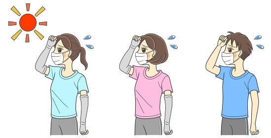 夏場のマスク着用で暑そうなTシャツの若い男女3人