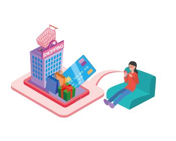 ソファに座ってネットショッピングする女性
