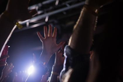 Crowd dancing at a rock concert