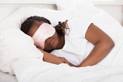 African Girl Sleeping In Bed
