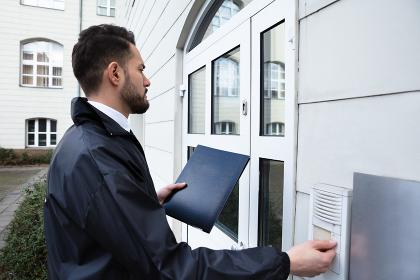 Man Pressing The Door Bell