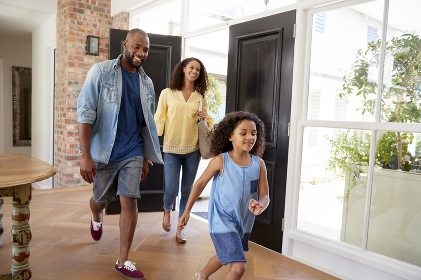 Mixed race couple and their daughter arriving home