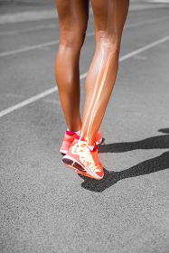 Low section of female athlete walking on sports track