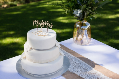 Decorated wedding cake on table
