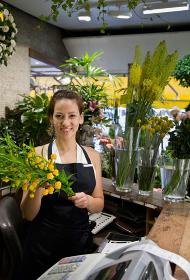 Female clerk in a flower shop