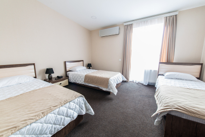 Triple room in modern hotel
