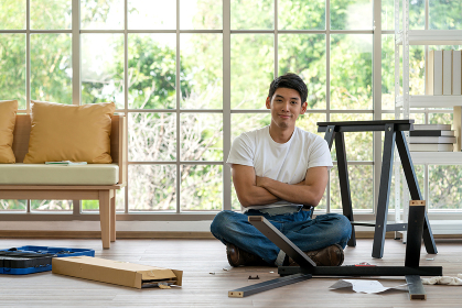 Handyman installing wooden bench in new house. House renovation service.