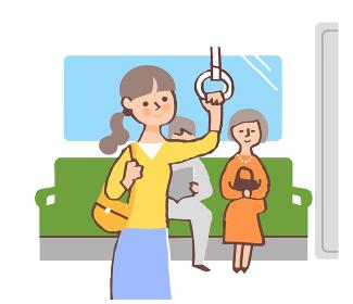 電車のつり革につかまる女性