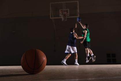 Two players playing basketball