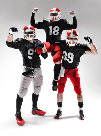 The three american football players posing on white background