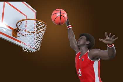 大柄のバスケットボールプレイヤーがダンクシュートをする