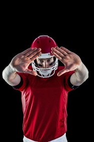 Portrait of american football player protecting himself