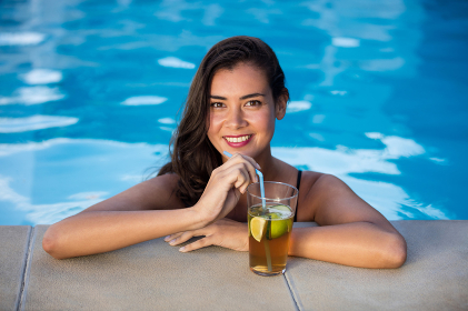 Portrait of young woman relaxing in the pool