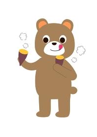 ほかほかの焼き芋を食べるクマ