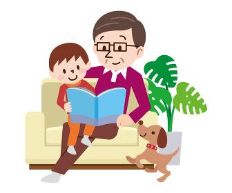 絵本を読む孫とおじいちゃん