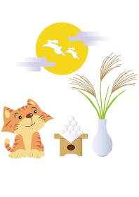 十五夜の満月と月見の飾りと猫