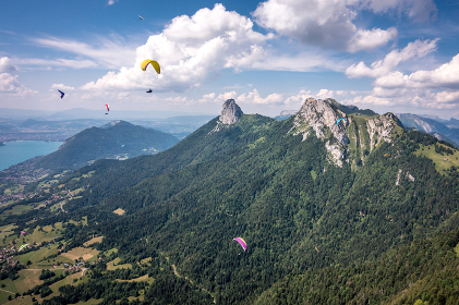 Paragliders & Hang Gliders Fly Over Granite Alps, Lake Annecy, France
