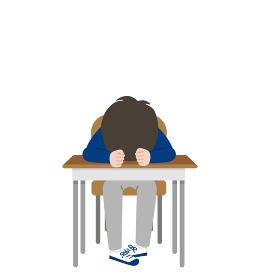 机に顔を伏せている元気のない男子学生