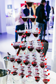 A pyramid of champagne and cherry glasses on holiday