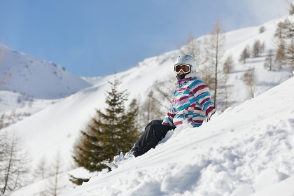 Snowboarder having a rest