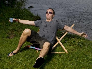 Man breaks garden chair and falls