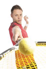 tennis player holding racket with ball in the camera
