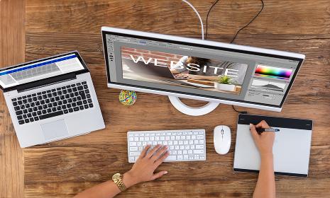 Designer Creating Website On Computer