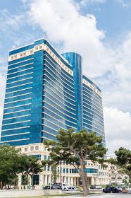 Baku - JULY 18, 2015: Hilton Hotel on July 18 in Baku, Azerbaijan. Baku has many modern hotels. Baku - JULY 18, 2015: Hilton Hotel on July 18 in Baku, Azerbaija