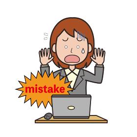 パソコン作業でミスをする女性会社員