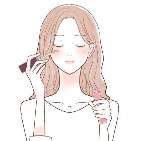 まつ毛美容液をまつ毛に塗ってまつ育する女性