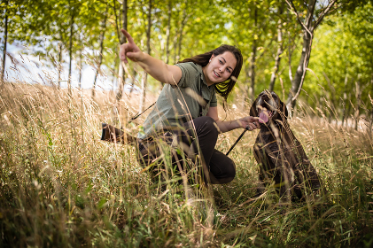 Autumn hunting season. Hunting. Outdoor sports. Woman hunter in the woods