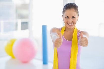 Portrait of happy woman at fitness studio