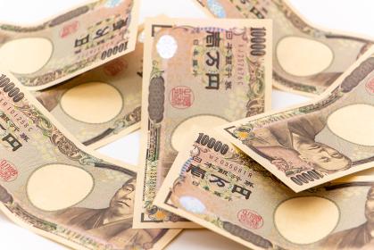 白背景ときれいに並べられた一万円札