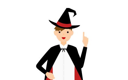 ハロウィンの仮装、魔法使い姿の男の子が指さしをするポーズ