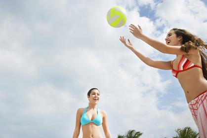 Teenage Girls Playing Beach Volleyball
