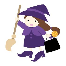 ハロウィン 魔女の仮装をする女の子