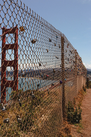 fence mesh with love locks at the Golden Gate Bridge in San Francisco