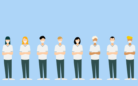 腕を組んでいる多国籍の医療従事者たち