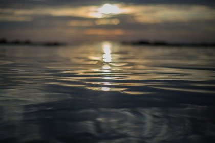 the reflection of the sun in the ocean