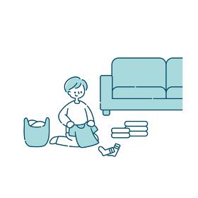 洗濯物を畳む男性