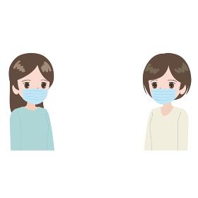 マスクをして離れて会話する女性たち
