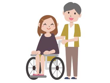 車椅子の若い女性と男性