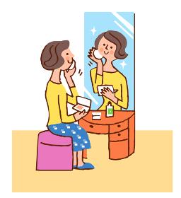 鏡台で化粧をする女性