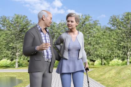 天気のいい日に池のある公園を散歩する笑顔のおじいさんと杖を持つおばあさん