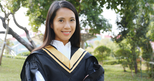 Young woman with graduation gown