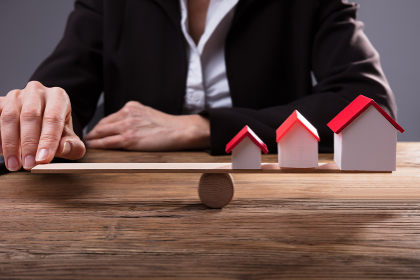 Human Finger Balancing House Models On Seesaw
