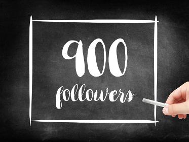 900 followers written on a blackboard