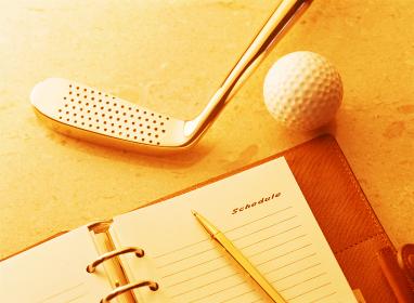 ゴルフクラブと手帳