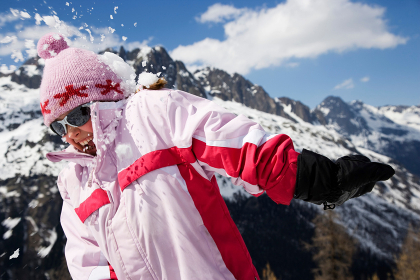 Girl in pink hit by snowball.